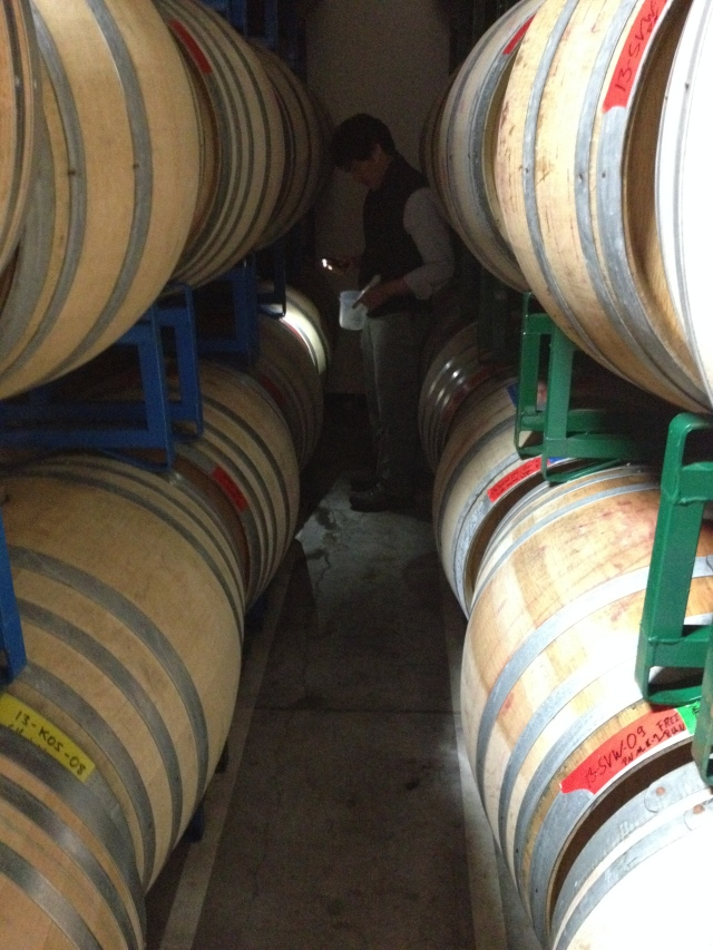 Byron, thief and flashlight in hand, among his barrels.