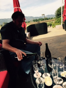 Our host pouring with the expansive Valley as a backdrop.