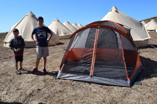 Our tent, which we put up in 50 miles an hour winds. You can see the fancy-pant tents in the background.