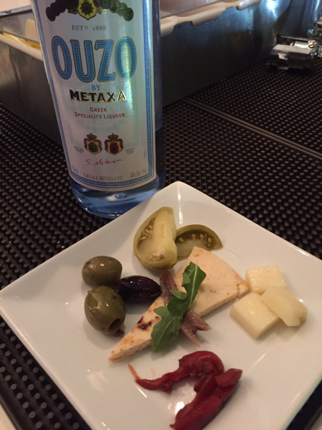 The manager of the restaurant, George, who is also Greek, said you can't eat Greek food without Ouzo. So we did with this welcoming plate of cheese, olives, and pickled tomatoes (which were made by Maria and were incredible).