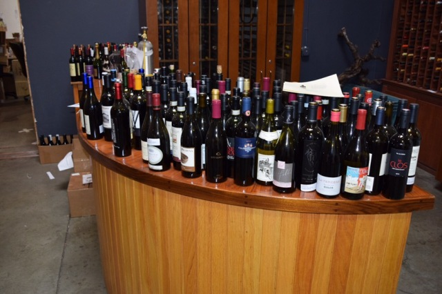 In the middle of the warehouse is this tasting table. All of these bottles have been sampled by using a Coravin.